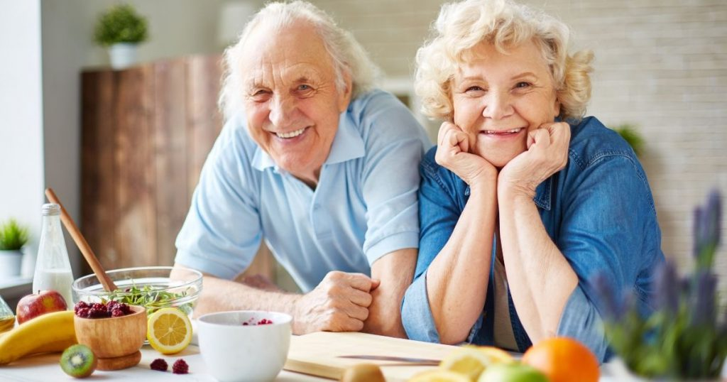 Senior Couple in Kitchen Preparing Meal